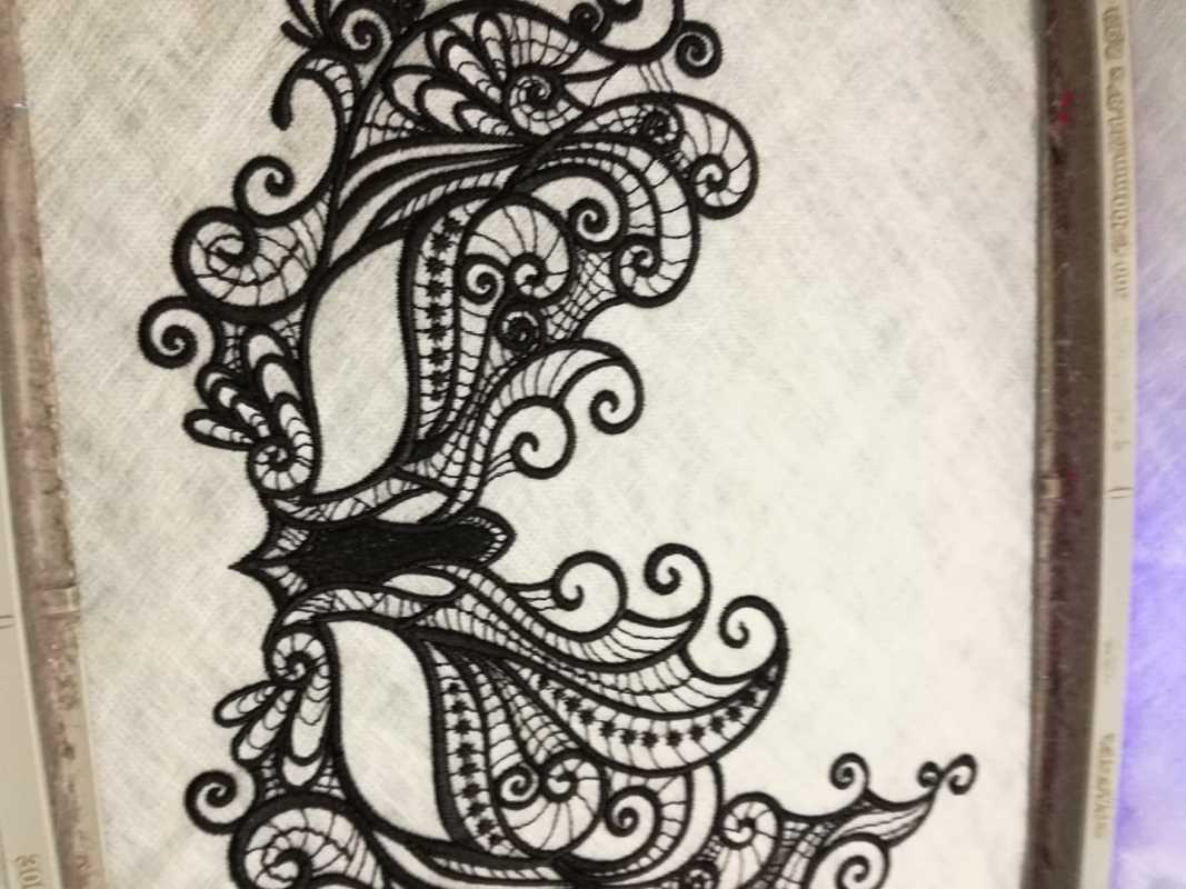 In hoop black theatre mask embroidery design