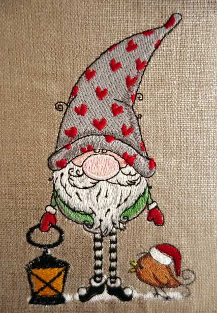 Embroidered Christmas gnome with bird design