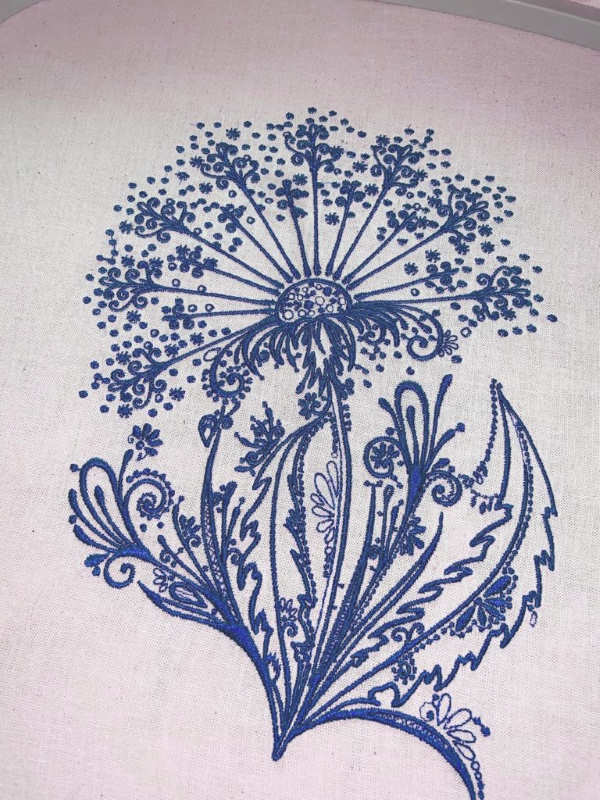 Dandelion dark blue embroidered design