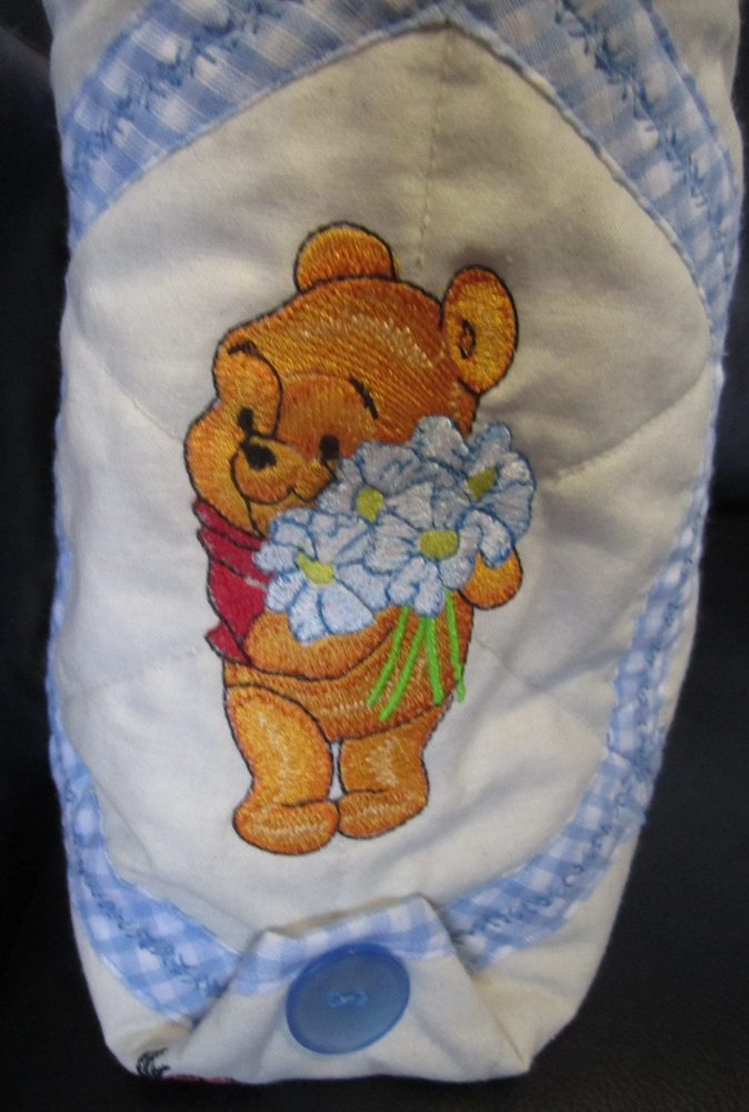 Baby Pooh with bouquet of chamomiles embroidered