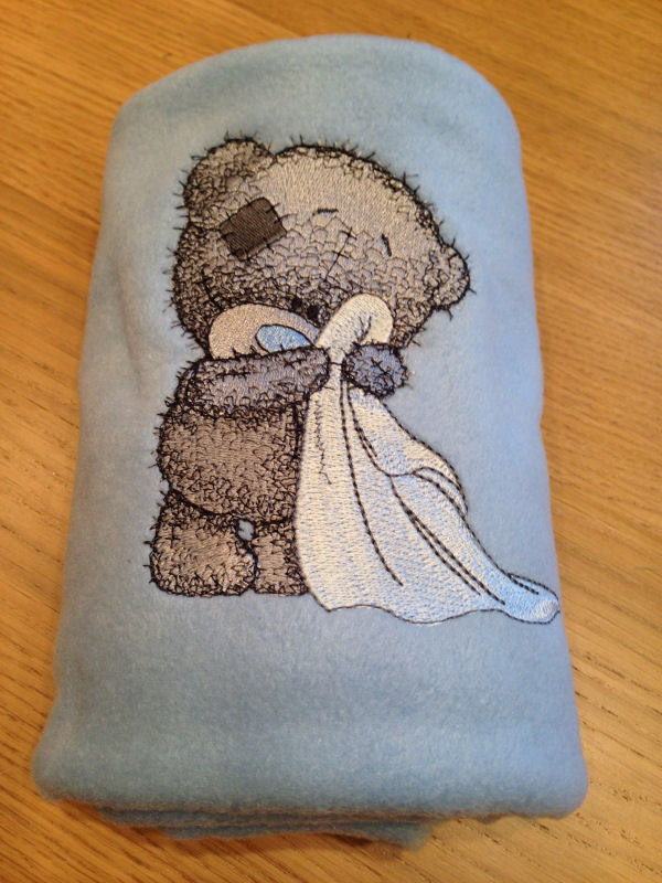 Shy teddy bear design on embroidered bath towel