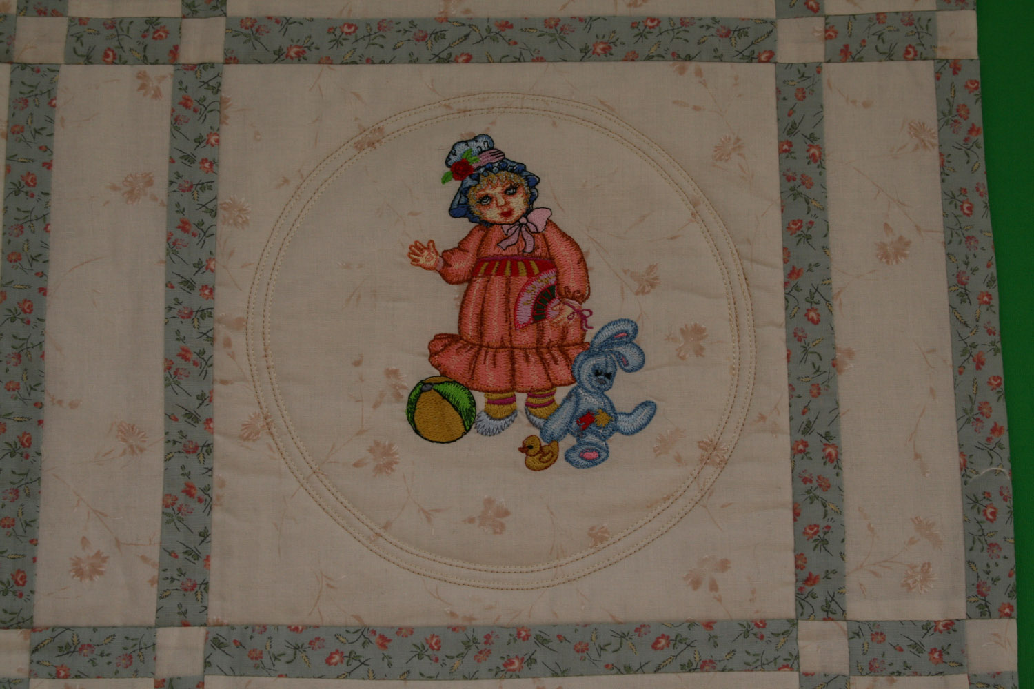 Doll with toys embroidered design