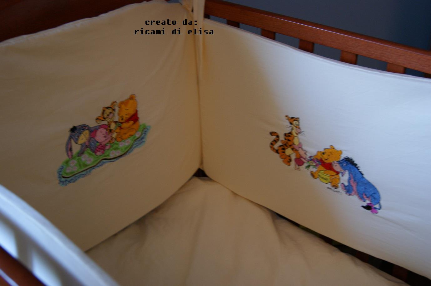 Winnie Pooh with his best friends on embroidered bed bumper