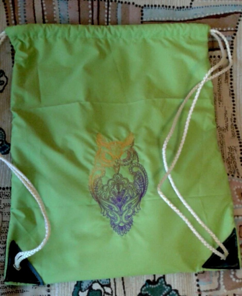 Owl embroidered on green bag
