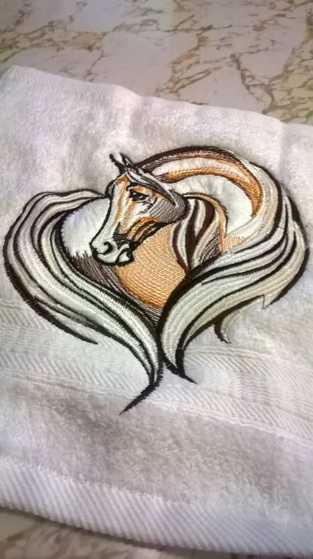 Embroidered towel with horse heart design