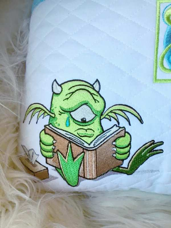 Cute monster reading book embroidery design