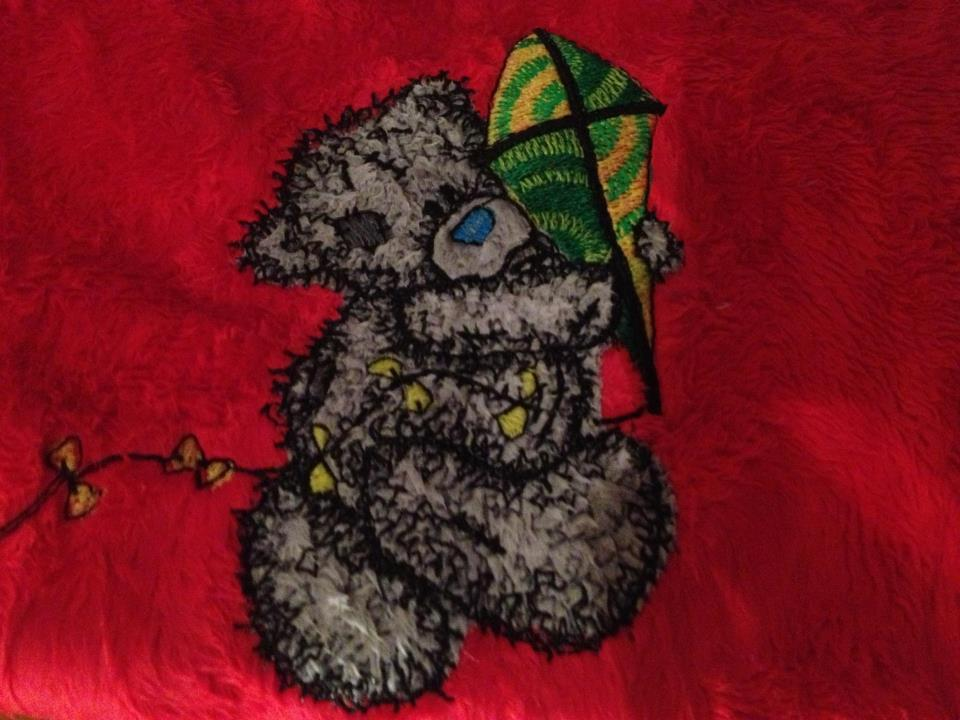 Teddy bear with kite applique embroidered