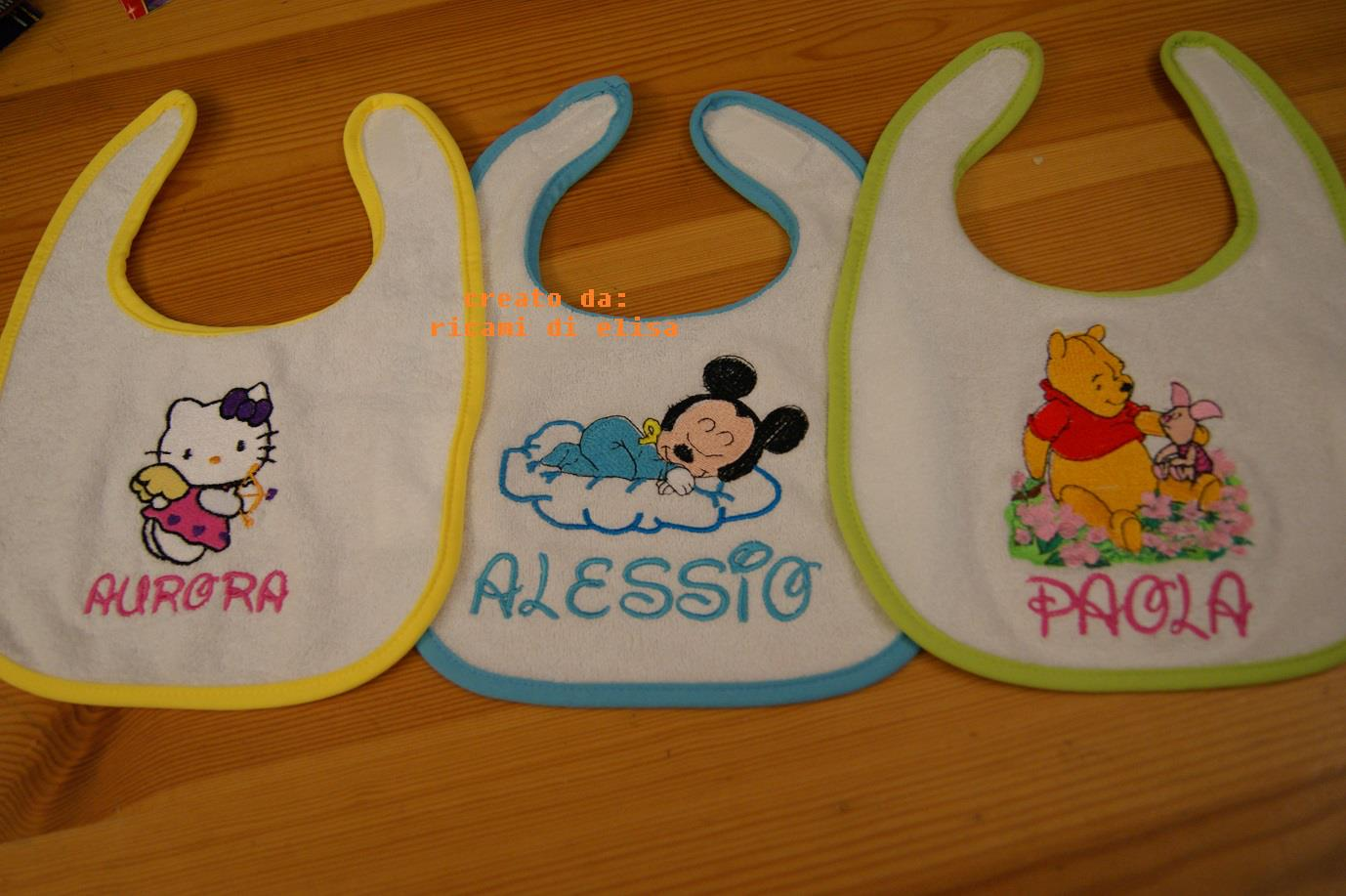Hello Kitty, Winnie Pooh and Mickey on embroidered baby bibs