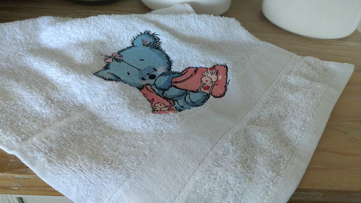 towel with teddy bear embroidery design