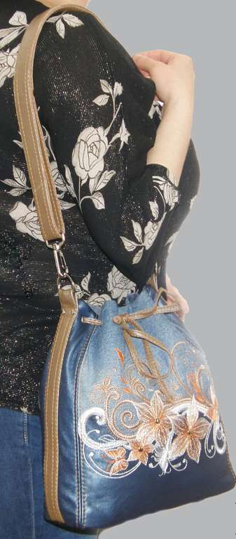 Embroidered leather bag with magic flower design