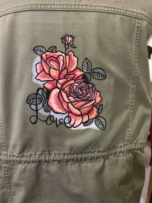 Denim jacket with love rose embroidery design