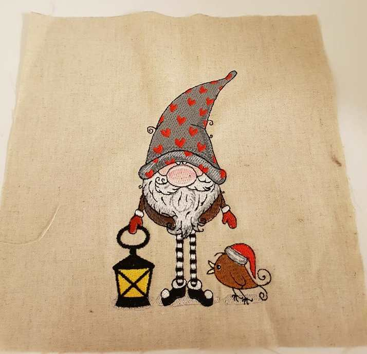 Cheerful and funny dwarf with bird embroidery design