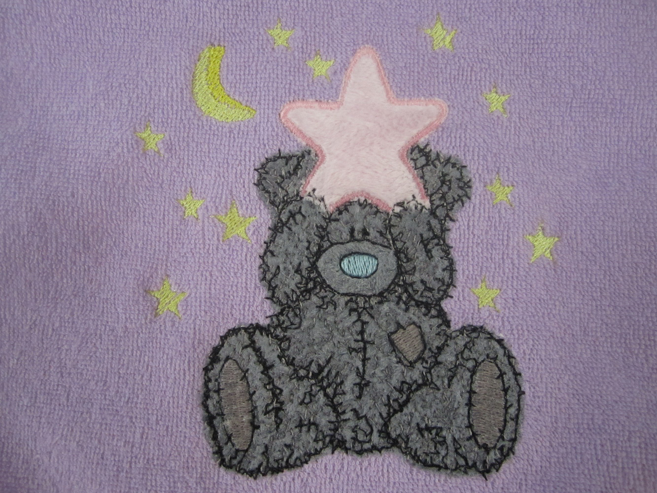 Purple baby bib embroidered with tatty teddy design