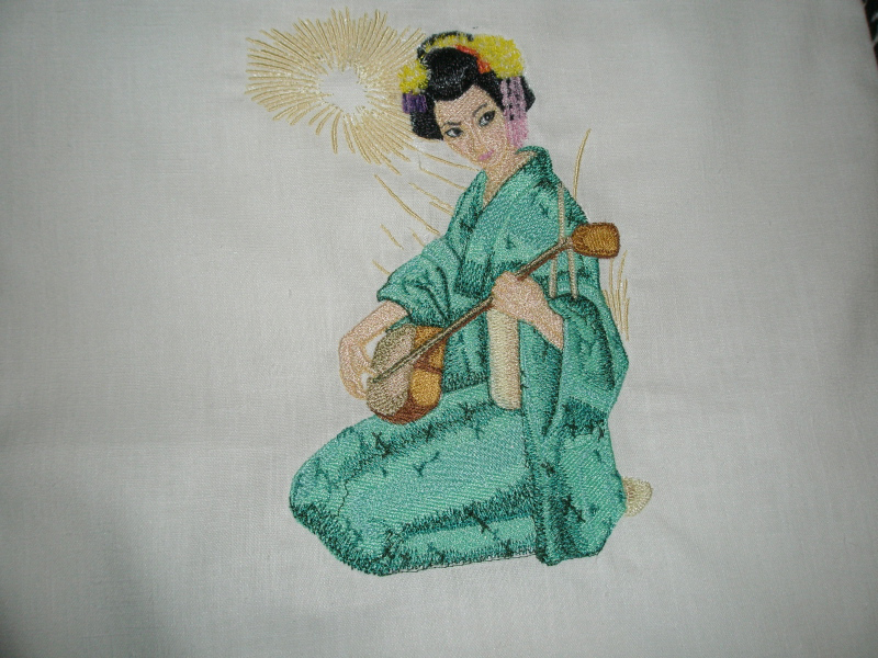 Embroidered Geisha with musical instrument design on pillowcase
