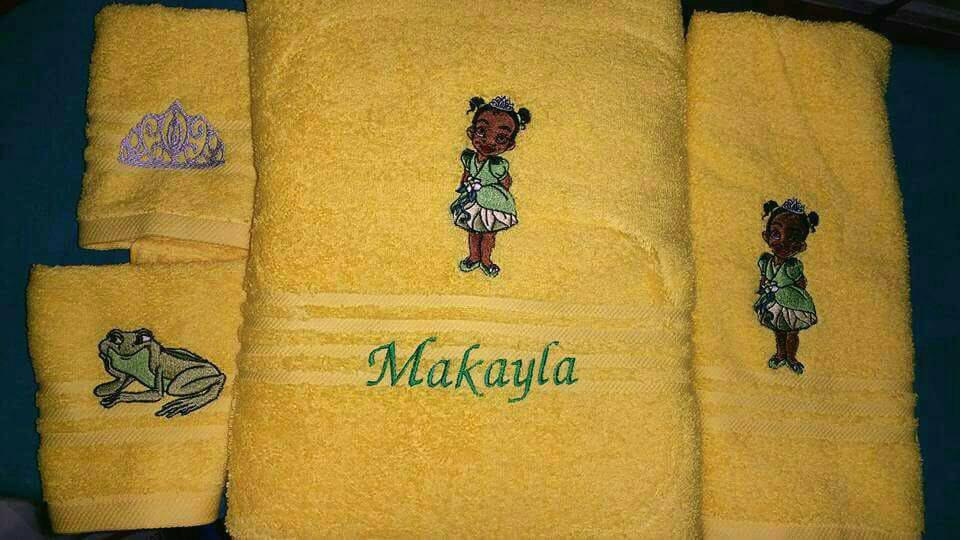 Princess and the frog designs on embroidered yellow bath towels