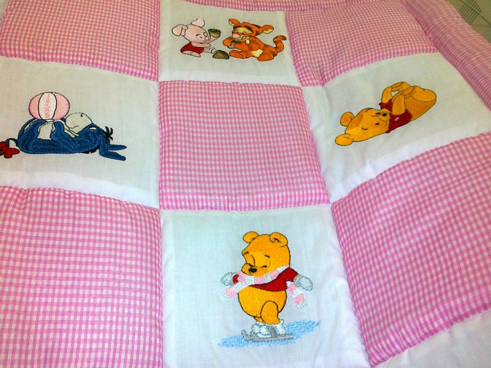 Pooh, Piglet, Tigger and Eeyore on embroidered quilt