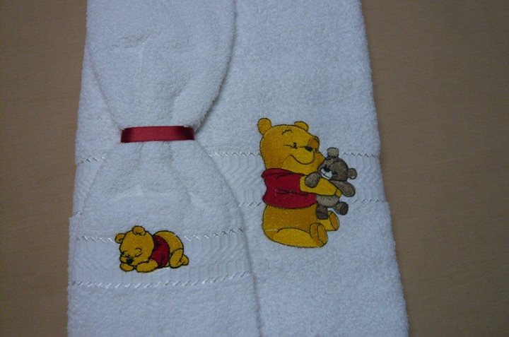 Towel with embroidered Pooh designs