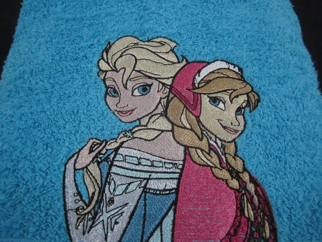 Embroidered Frozen Anna and Elsa on bath towel