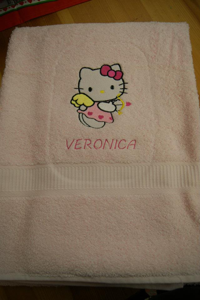 Embroidered Hello Kitty Cupid design on towel