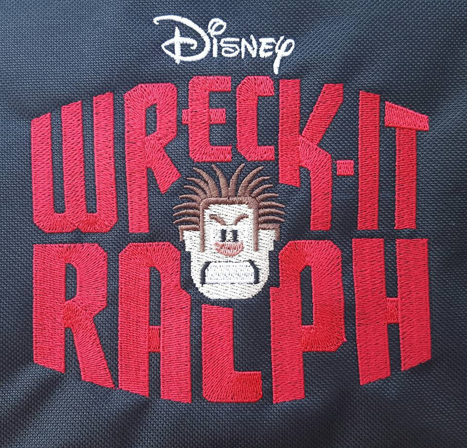 Embroidered Wreck-It Ralph logo on black bag