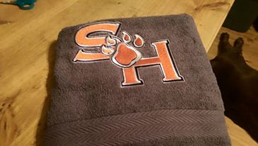 Embroidered Sam Houston State University design on towel