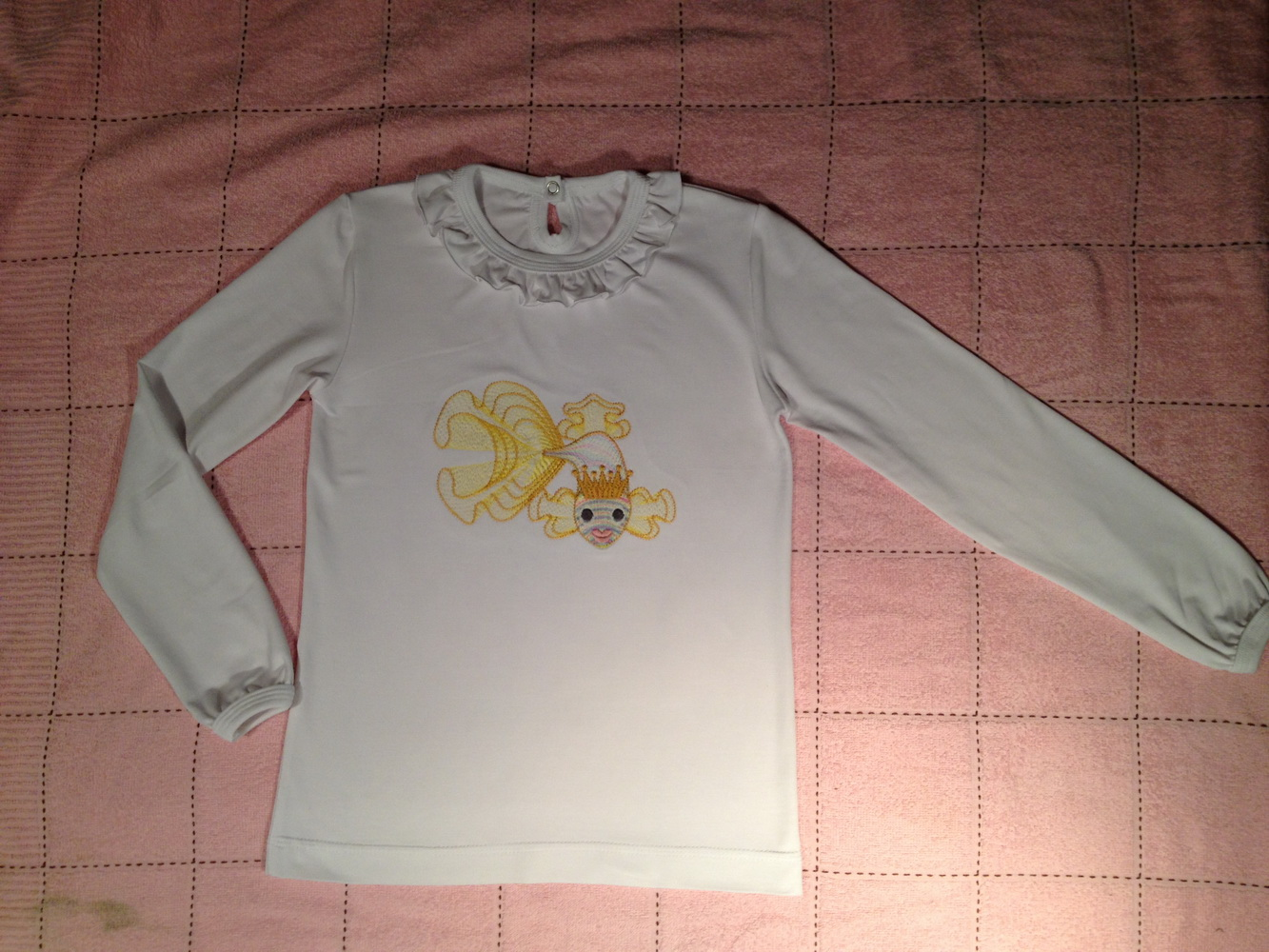 Gold fish on white shirt embroidered