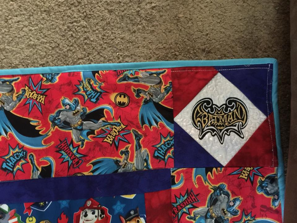 Batman modern logo embroidered design on quilt