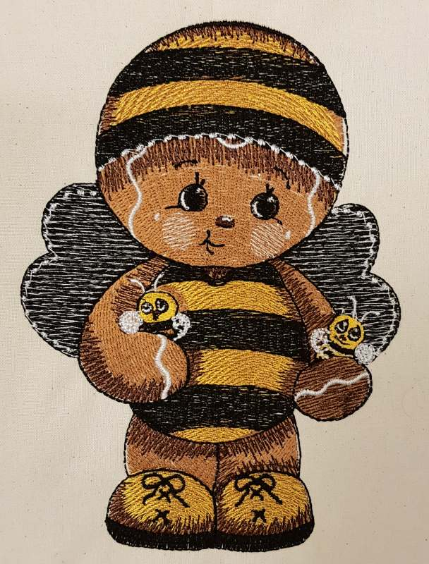 Embroidered gingerbread boy in bee costume design