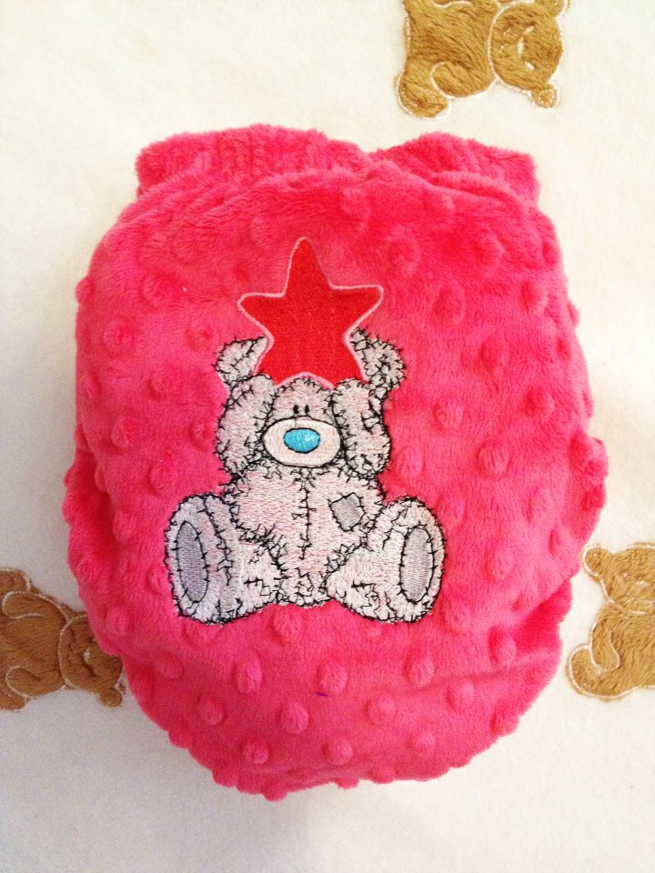 Teddy bear happy Christmas design on embroidered nappy cover