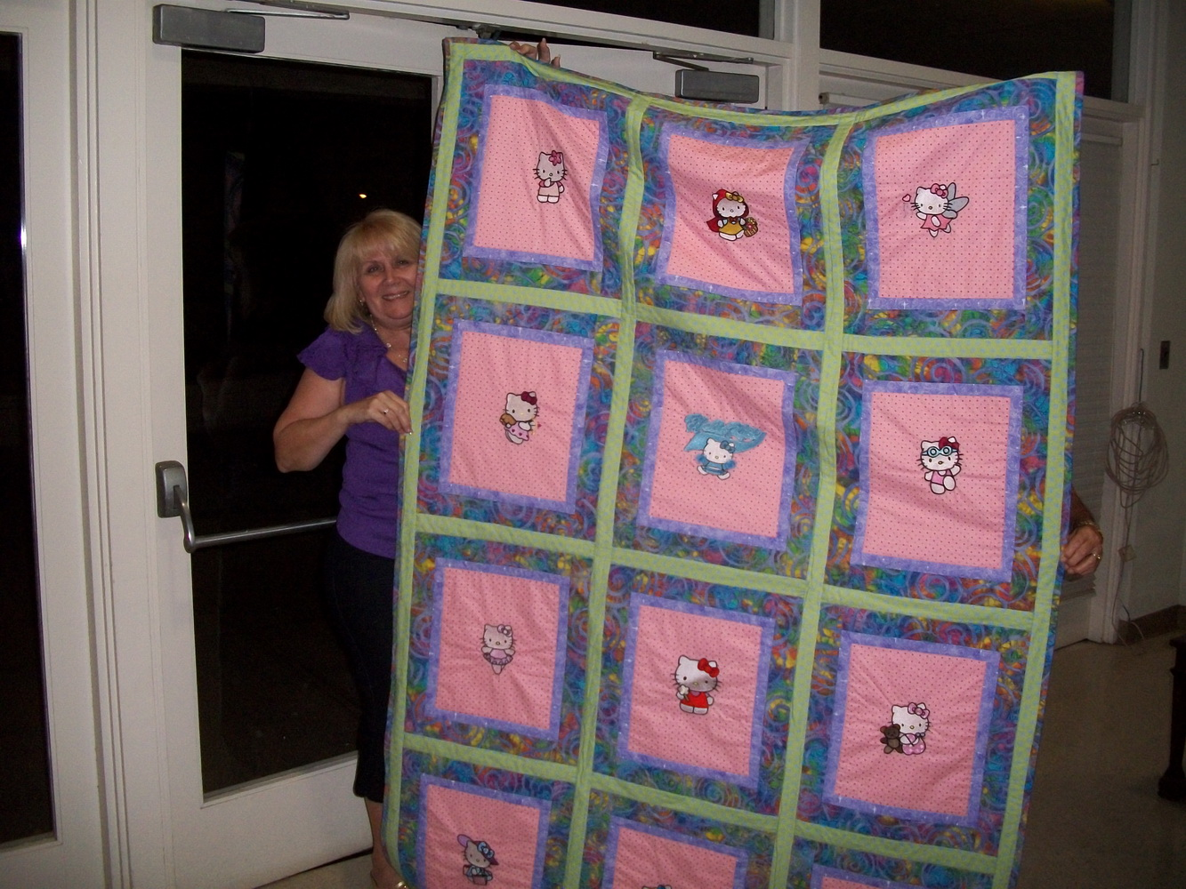 Embroidered Hello Kitty designs on blanket