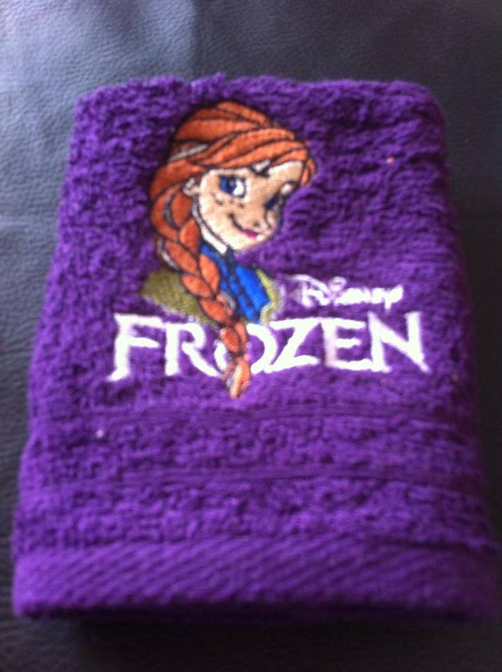 Purple embroidered towel with cute Anna