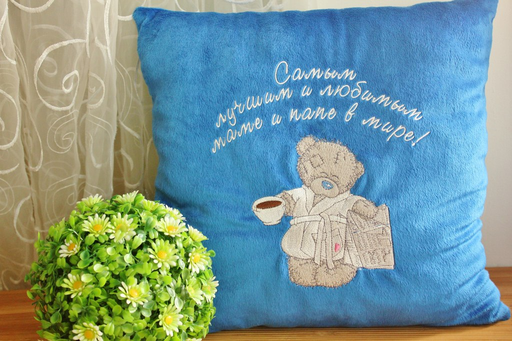Embroidered pillowcase with blue nose teddy bear with newspaper