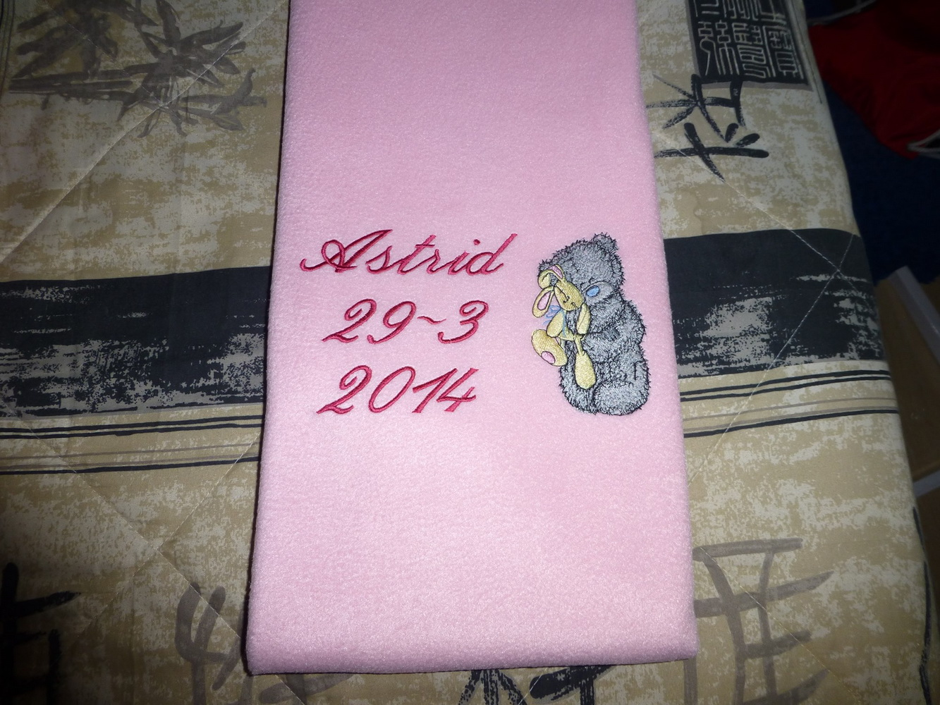 Fleece pink blanket embroidered with cute blue nose teddy bear