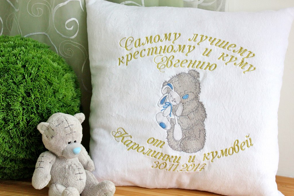 embroidered cushion with teddy bear toy design