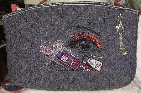 Embroidered purse with make up design