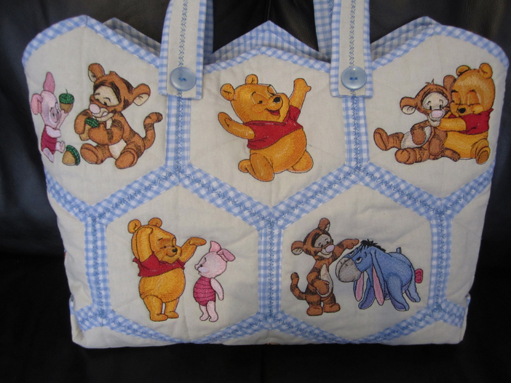Baby pooh designs embroidered on nappy bag