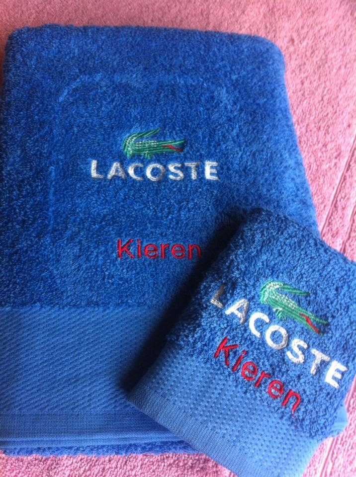 Lacoste logo design on towel embroidered