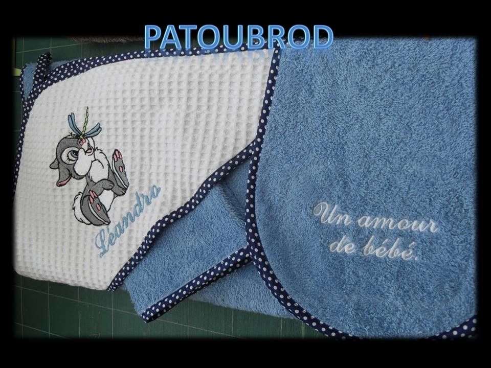 Boy's bath towel with embroidered bunny and dragonfly