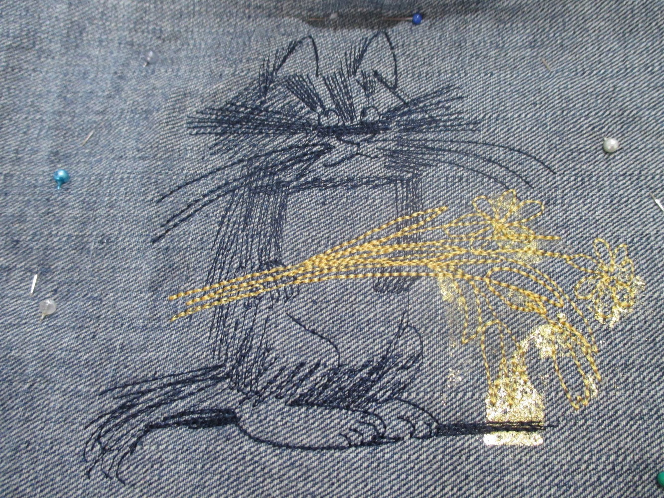 Embroidered Unhappy cat with flowers
