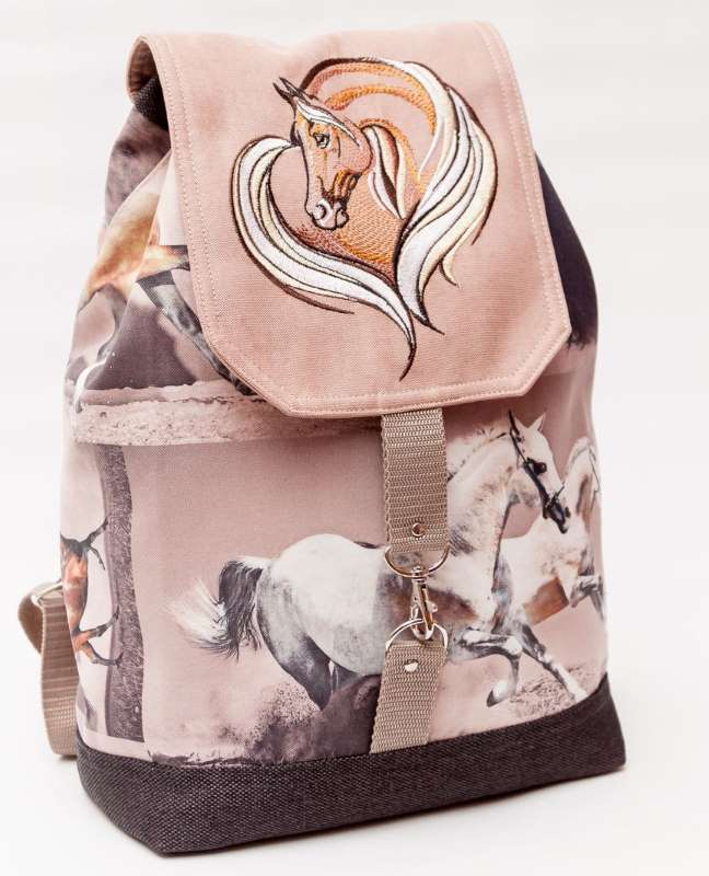 Embroidered backpack with horse heart design