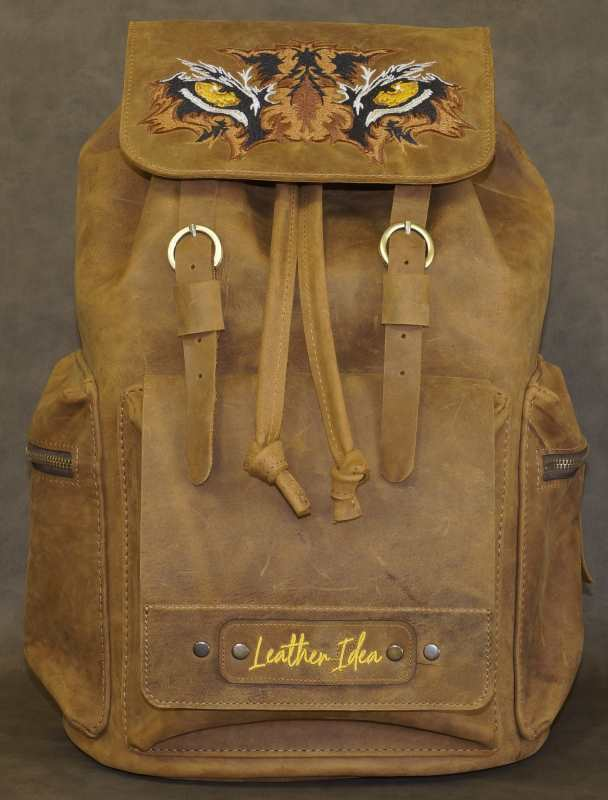 Leather backpack embroidered with back pack design