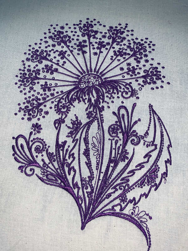 Embroidered dandelion design