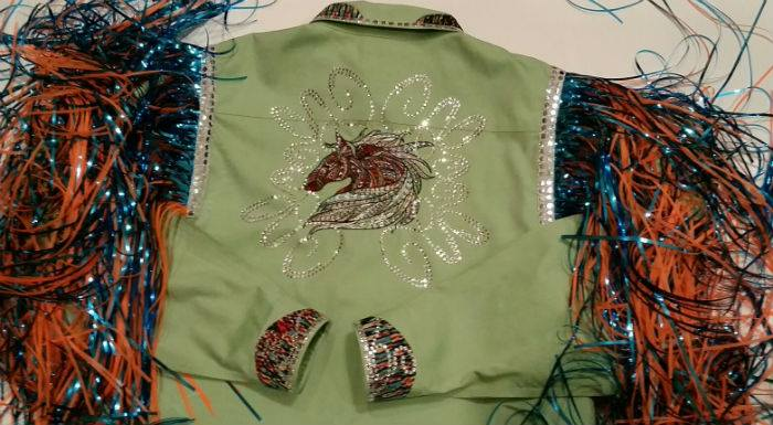 Green shirt embroidered with horse design