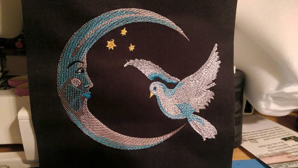 Embroidered Crescent and dove design on pillowcase