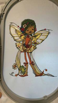 Young fairy with frog embroidery design in hoop