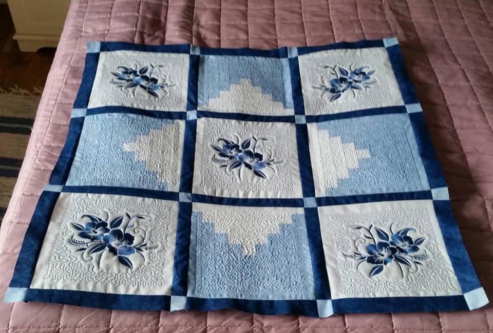 Cute quilt with embroidered flowers