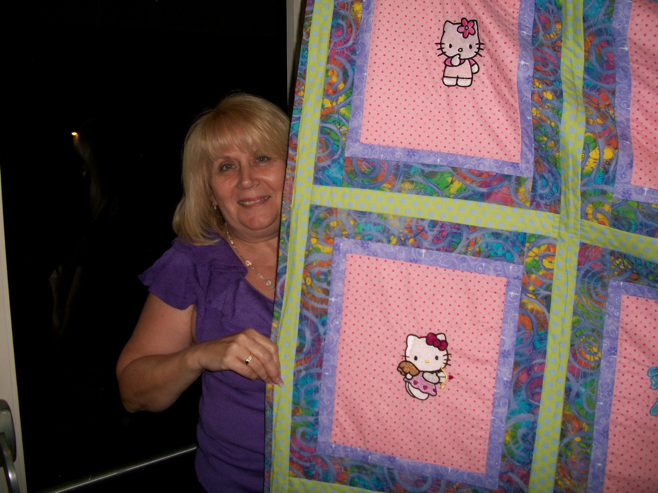 Hello Kitty designs on embroidered blanket
