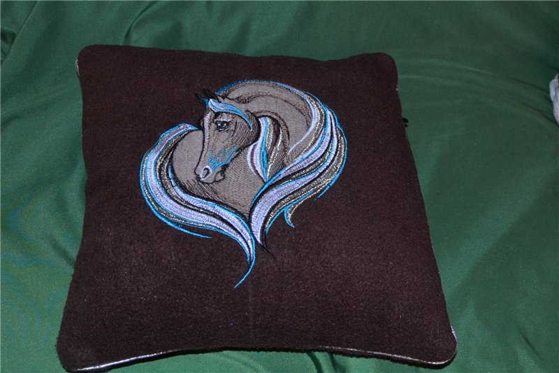 Brown pillowcase with embroidered horse heart