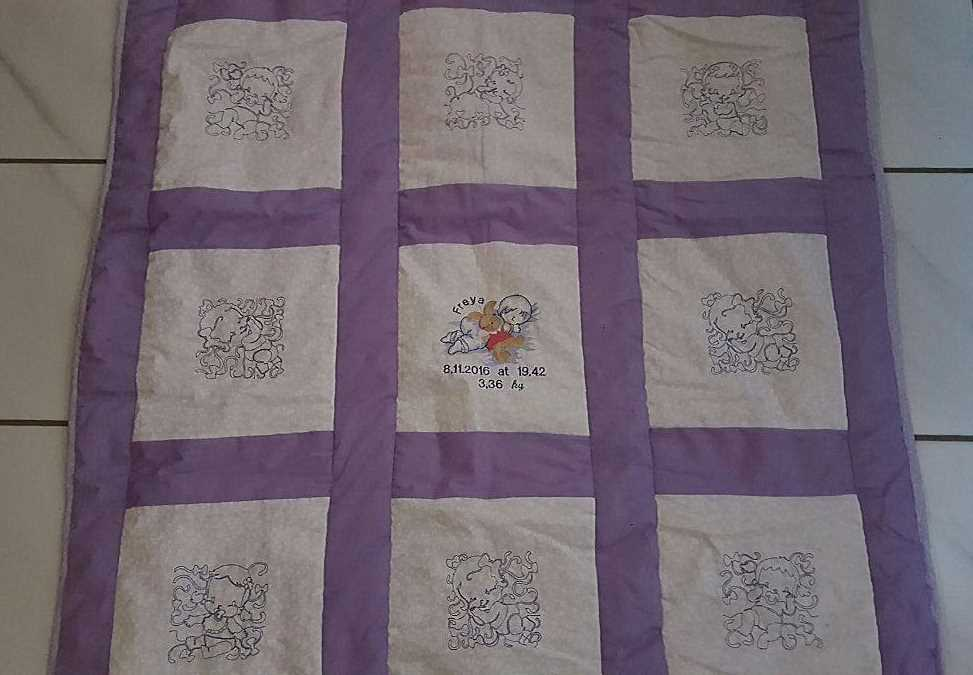 baby quilt with embroidery designs