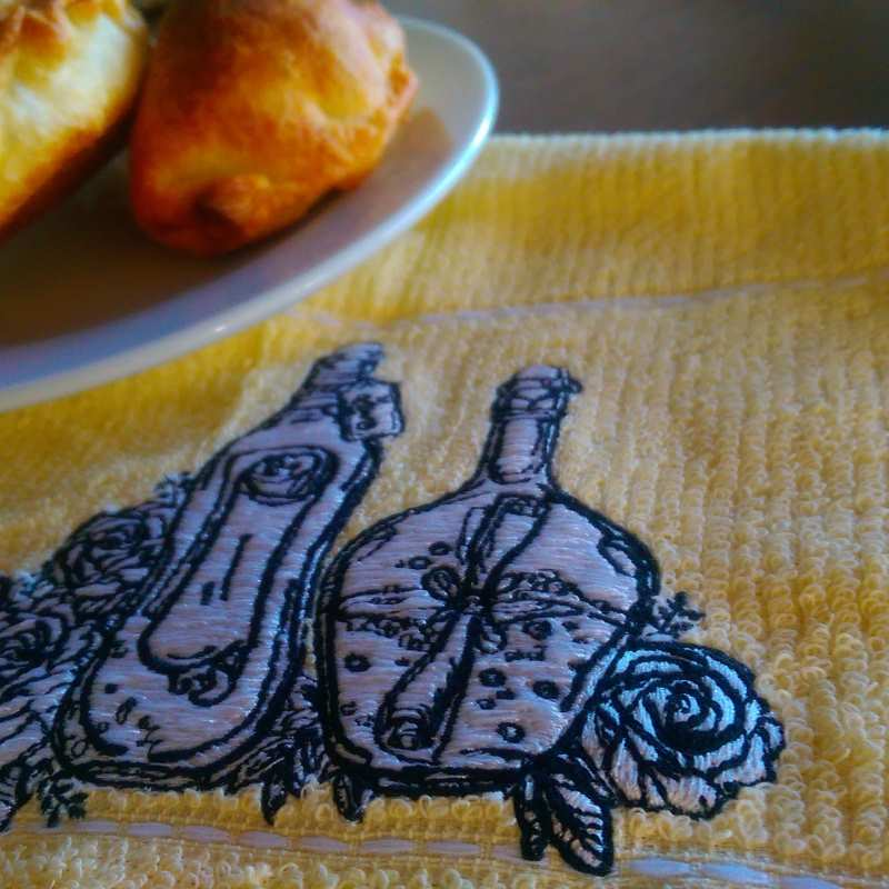 Kitchen towel with Bottle and flowers embroidery design